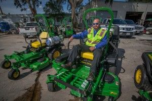 Stay Green Account Manager Dave Colburn gets ready to take a new propane mower for a spin.