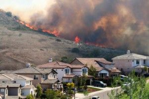 Wild fire in the hills above homes
